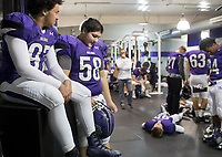 NWA Democrat-Gazette/CHARLIE KAIJO Fayetteville High School football players wait for coach to address the team ahead of a playoff football game on Friday, November 10, 2017 at Fayetteville High School in Fayetteville.