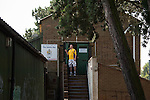 St Albans 0 Watford 5, 26/07/2014. Clarence Park, Pre Season Friendly. Pre Season friendly between St Albans City and Watford from Clarence Park Stadium. A fan catches a glimpse of the game from the bar.Watford won the game 5-0. Photo by Simon Gill.