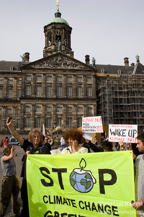 Global Wake Up Call on the Dam Square on September 21st, 2009. The flash mob gathered at 12:18 pm to call the Dutch Prime Minister and demand the world wake up and solve climate change.
