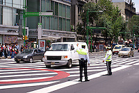 Policemen directing traffic in downtown Mexico City