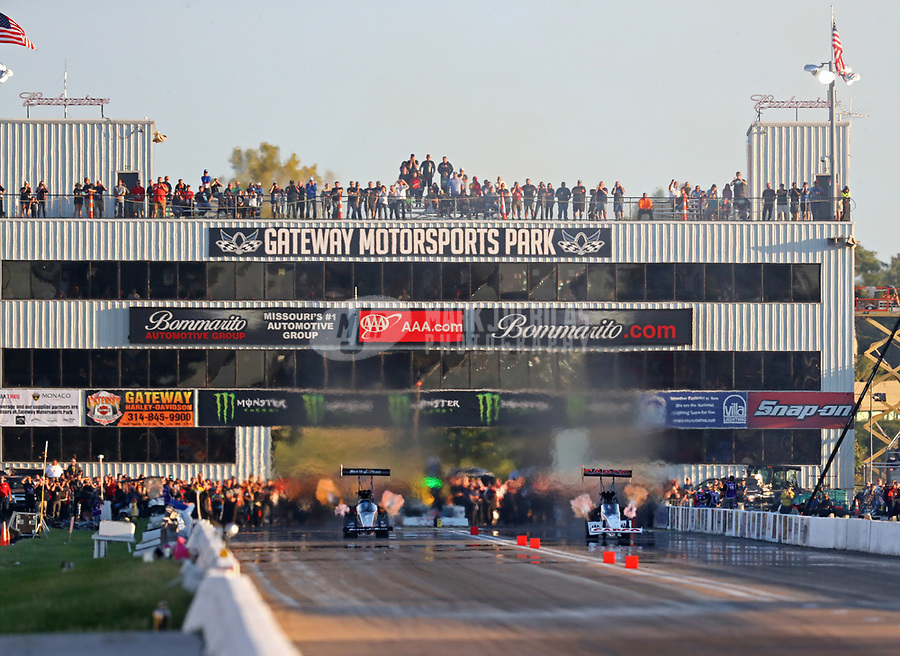 Sep 22, 2018; Madison, IL, USA; NHRA top fuel driver Clay Millican (left) races alongside Steve Torrence during qualifying for the Midwest Nationals at Gateway Motorsports Park. Mandatory Credit: Mark J. Rebilas-USA TODAY Sports