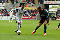 Sunday, 26 April 2014<br /> Pictured L-R: Pablo Hernandez of Swanse against Nathan Baker of Aston Villa.<br /> Re: Barclay's Premier League, Swansea City FC v Aston Villa at the Liberty Stadium, south Wales.