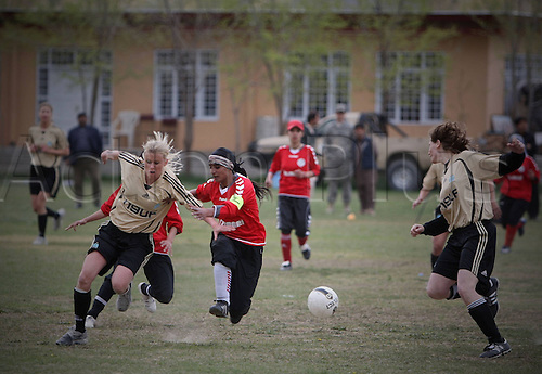 01 04 2011 Players of Both team Fight for The Ball during A Friendly Match between Afghan Women s National Soccer team and NATO LED International Security AID Force Women s Soccer team in Kabul Capital of Afghanistan ON April 1 2011 The Match Ended with A 0 0 Tie