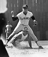 Giants Tito Fuentes stands over Oakland A's Tommy Davis.(1970 photo/Ron Riesterer (