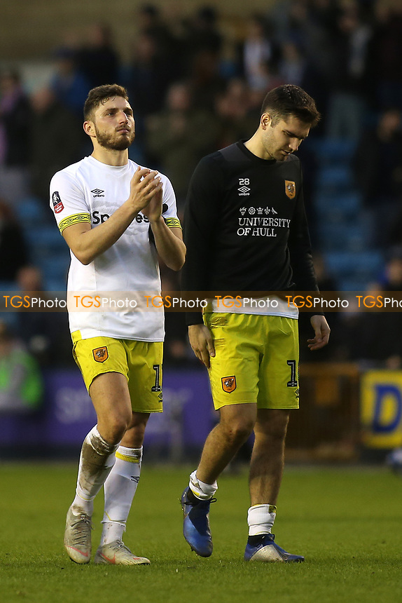 Despair for Hull City's David Milinkovic and Jon Toral as they walk off the pitch at the final whistle after losing 2-1 having conceded two late goals during Millwall vs Hull City, Emirates FA Cup Football at The Den on 6th January 2019