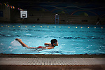 A boy swims in the swimming pool at Faith Academy in Manila, Philippines.