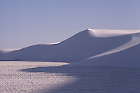 SAND DUNES<br /> (Variations Available)<br /> Barchanoid Dune, White Sands Nat. Monument<br /> <br /> The dunes are formed of gypsum.  Deposits of selenite crystals are broken down into sand sized grains due to weather erosion. Prevailing wind carries the grains away forming constantly shifting dunes.