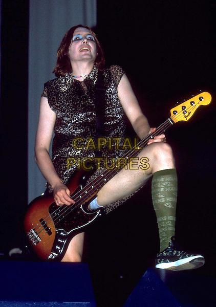 NICKY WIRE of MANIC STREET PREACHERS.Performs live in concert at the V Festival, Chelmsford, Essex, England, 21st August 1999..full half length V99 guitar band on stage gig music group socks leg pants crotch leopard print dress make-up eyeshadow drag leg up.CAP/JM.©James McCauley/Capital Pictures