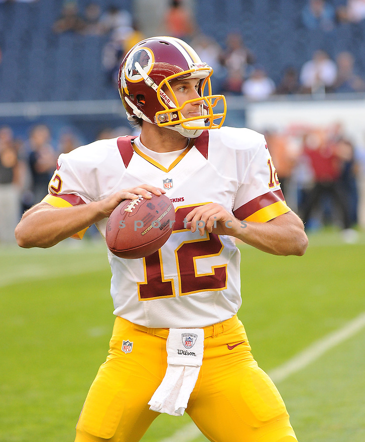 KIRK COUSONS (12), of the Washington Redskins, in action during the Redskins game against the Chicago Bears on August 18, 2012 at Soldier Field in Chicago, IL. The Bears beat the Redskins 33-31.