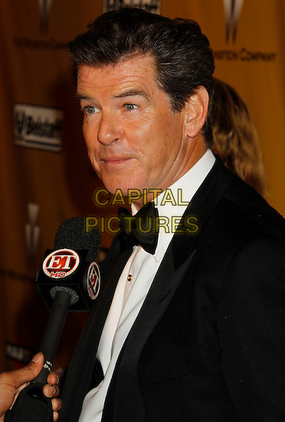 PIERCE BROSNAN.Weinstein Company Post Golden Globe Party held at Bar210 & Plush Ultra Lounge at the Beverly Hilton Hotel, Beverly Hills, California, USA..January 17th, 2009.globes headshot portrait black white bow tie tuxedo microphone interview funny face.CAP/ADM/MJ.©Michael Jade/Admedia/Capital Pictures