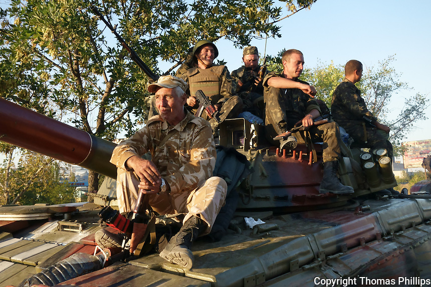 Ukrainian Army soldiers on a tank in Mariupol returning from battle against pro-Russian separatists. September, 2014.