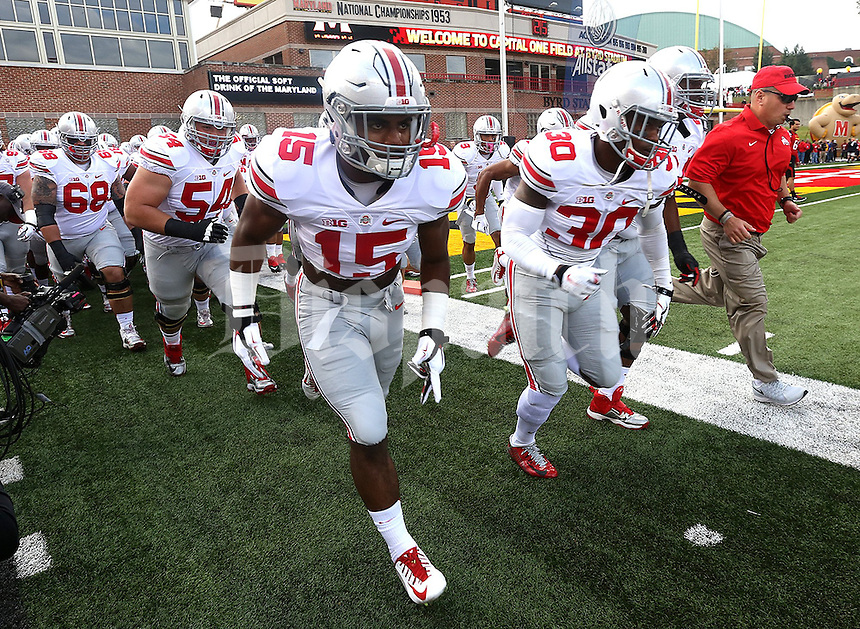 Ohio State Buckeyes running back Ezekiel Elliott (15) leads the team entrance to the field at the beginning of the Ohio State University football game against the Maryland Terrapins at Byrd Stadium in College Park, Maryland on October 4, 2014. (Columbus Dispatch photo by Brooke LaValley)