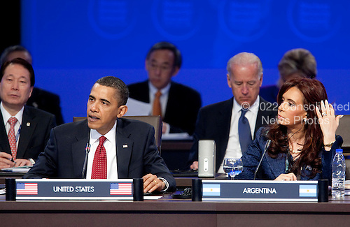 United States President Barack Obama speaks during the opening plenary session of the Nuclear Security Summit with Cristina Fernandez de Kirchner, Argentina's president, right, and U.S. Vice President Joseph Biden at the Washington Convention Center in Washington, D.C., U.S., on Tuesday, April 13, 2010. Ukraine's agreement to relinquish its entire stockpile of highly enriched uranium gave Obama the first concrete result for a summit he convened on securing the world's atomic material. .Credit: Andrew Harrer / Pool via CNP