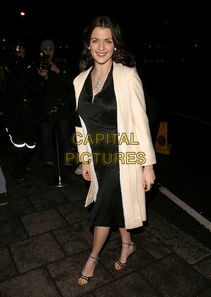 RACHEL WEISZ.Finch & Partners' Pre-BAFTA Party, Annabel's, Berkeley Square, London, England, .February 18th 2006..full length black dress white cream coat.Ref : AH.www.capitalpictures.com.sales@capitalpictures.com.©Adam Houghton/Capital Pictures.