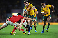 Bernard Foley of Australia sniffs the one but is tackled by Gareth Anscombe of Wales during Match 35 of the Rugby World Cup 2015 between Australia and Wales - 10/10/2015 - Twickenham Stadium, London<br /> Mandatory Credit: Rob Munro/Stewart Communications
