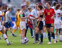 REIMS,  - JUNE 24: Megan Rapinoe #15 exchanges jerseys with Marta Corredera #7 during a game between NT v Spain and  at Stade Auguste Delaune on June 24, 2019 in Reims, France.