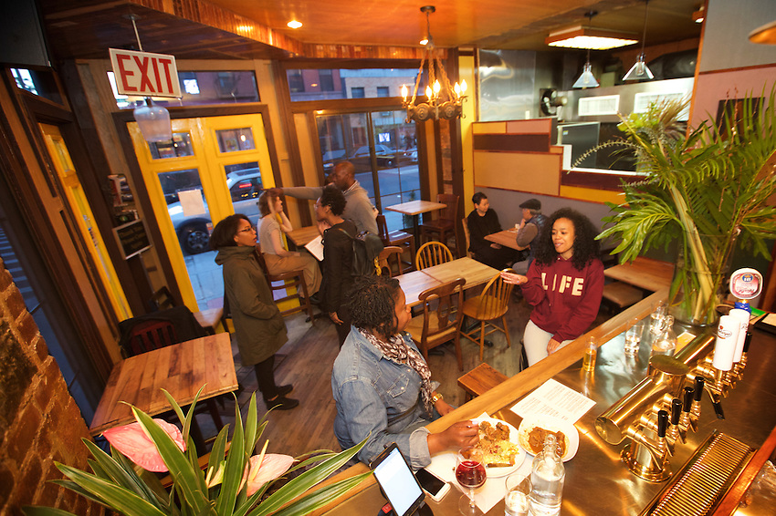 BROOKLYN, NY - Angela's, a small West Indian restaurant on Nostrand Avenue in Bedford-Stuyvesant.<br /> <br /> CREDIT: Clay Williams for the James Beard Foundation.<br /> <br /> &copy; Clay Williams / claywilliamsphoto.com