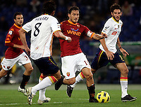 Calcio, Serie A: Roma-Lecce. Roma, stadio Olimpico, 30 ottobre 2010..Football, Italian serie A: AS Roma vs Lecce. Rome, Olympic stadium, 30 october 2010..AS Roma forward Francesco Totti, center, is challenged by Lecce midfielders Gianni Munari, left, and Ignacio Piatti. .UPDATE IMAGES PRESS/Riccardo De Luca