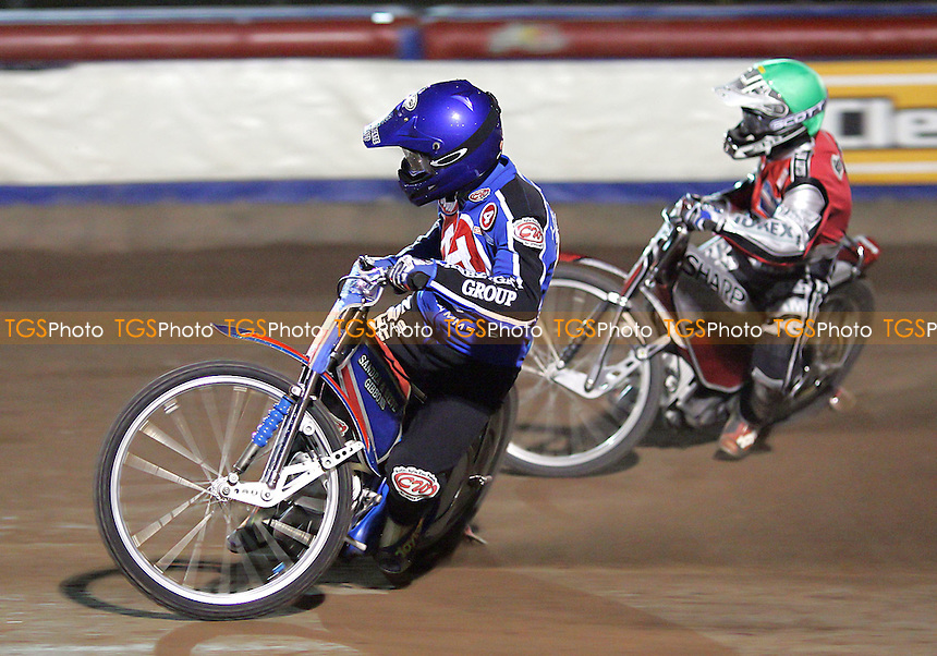 Arena Essex Hammers vs Peterborough Panthers - Elite League Knockout Cup 1st Round, 1st Leg 31/03/06 - Heat 9 - Leigh Lanham (blue) stays ahead of Peterborough's Ryan Sullivan on his way to maximum points - (Gavin Ellis 2006)