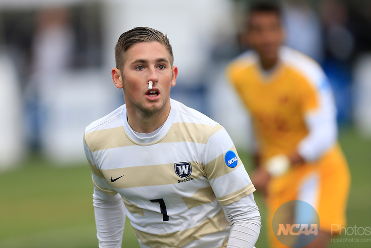 KANSAS CITY, MO - DECEMBER 03:  Christian Szalay (7) of Wingate University looks for an opening in the University of Charleston defense during the Division II Men's Soccer Championship held at Children's Mercy Victory Field at Swope Soccer Village on December 03, 2016 in Kansas City, Missouri. Wingate beat Charleston 2-0 to win the National Championship. (Photo by Jack Dempsey/NCAA Photos via Getty Images)
