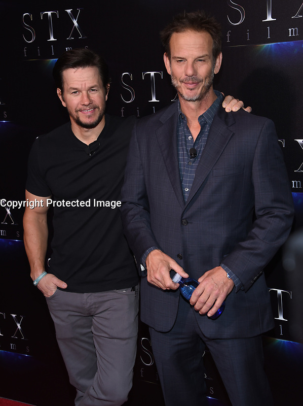 Mark Wahlberg + Peter Berg @ the photocall for STX Films 'The State of the Industry: Past, Present and Future' held @ The Colosseum at Caesars Palace.<br /> March 28, 2017 , Las Vegas, USA. # CINEMA CON 2017 - PHOTOCALL 'THE STATE OF THE INDUSTRY'