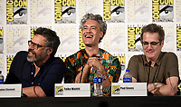 FX FEARLESS FORUM AT SAN DIEGO COMIC-CON© 2019: L-R: Cast Member/Director/Writer/Producer Jemaine Clement, Writer/Producer/Cast Member Taika Waititi and Executive Producer Paul Simms during the WHAT WE DO IN THE SHADOWS panel on Saturday, July 20 at SAN DIEGO COMIC-CON© 2019. CR: Frank Micelotta/FX/PictureGroup © 2019 FX Networks