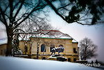 Winter scene of Dayton Art Institute. Leo the lion in front of the building.