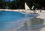 Tourists walking along the golden Sandy Lane beach in Barbados 1976