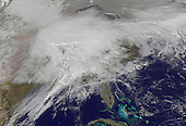 This visible image was captured by the GOES-13 satellite and shows the low pressure area stretching from the Colorado Rockies and Texas east to New England. The image shows the storm on Feb. 1 at 1401 UTC (9:01 a.m. EST) by the NASA GOES Project, located at NASA's Goddard Space Flight Center in Greenbelt, Md. The GOES series of satellites are operated by NOAA. .Credit: NOAA/NASA GOES Project via CNP
