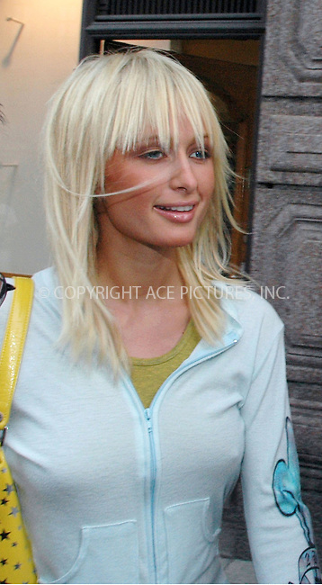 Paris Hilton attended evening private hairstyling at Toni & Guy in Stockholm together with boyfriend Nick Carter who also had his hair styled at the same time. - 9 July 2004..FAMOUS PICTURES AND FEATURES AGENCY.tel  +44 (0) 20 7731 9333.fax +44 (0) 20 7731 9330.e-mail info@famous.uk.com.www.famous.uk.com.FAM13207