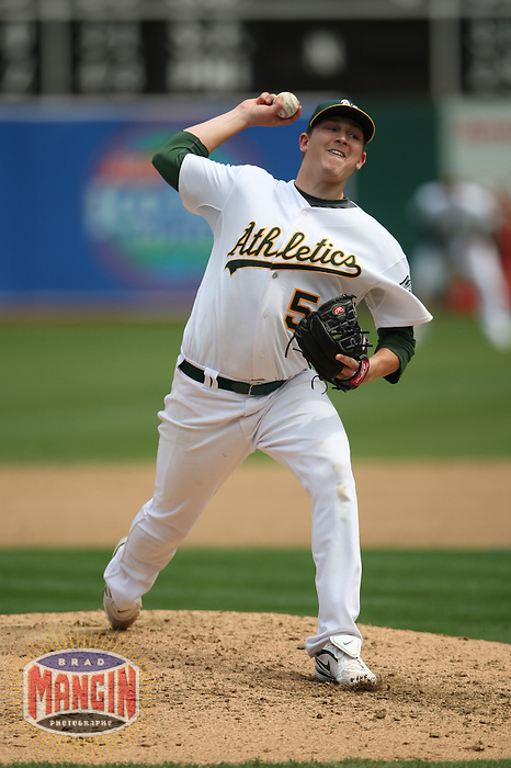 OAKLAND, CA - SEPTEMBER 2:  Trevor Cahill #53 of the Oakland Athletics pitches against the Kansas City Royals during the game at the Oakland-Alameda County Coliseum on September 2, 2009 in Oakland, California. Photo by Brad Mangin