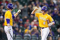 LSU Tigers outfielder Andrew Stevenson (6) is greeted by teammate Jake Fraley (23) after scoring during the Houston College Classic against the Nebraska Cornhuskers on March 8, 2015 at Minute Maid Park in Houston, Texas. LSU defeated Nebraska 4-2. (Andrew Woolley/Four Seam Images)