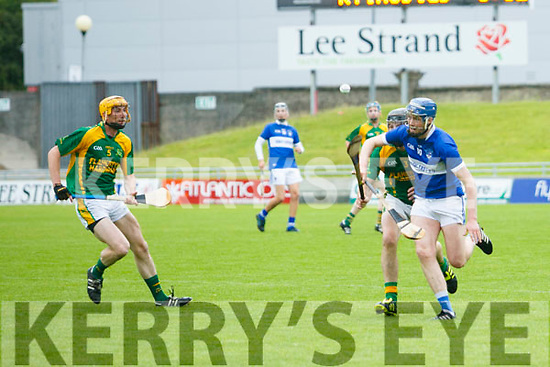 St. Brenda's Tim Hannafin get away from Kilmoyley's Colman Savage and Tom Murnane in the Kilmoyley v St Brendans in the Garvey's Supervalu Senior County Hurling Championship 2017 Round 2A at Austin Stack Park on Saturday