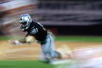 OAKLAND, CA - Tim Brown of the Oakland Raiders runs with the football during a game against the Kansas City Chiefs at the Oakland Coliseum in Oakland, California in 1997. Photo by Brad Mangin