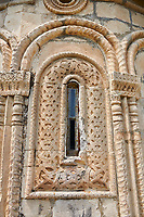 Pictures & images of Nikortsminda ( Nicortsminda ) St Nicholas Georgian Orthodox Cathedral exterior and its Georgian relief sculpture stonework window decorations, 11th century, Nikortsminda, Racha region of Georgia (country). A UNESCO World Heritage Tentative Site.