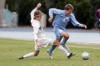 UNC's Michael Harrington (right) beats SMU's Scott Corbin (left) in midfield. Southern Methodist University defeated the University of North Carolina 3-2 in double overtime at Fetzer Field in Chapel Hill, North Carolina, Saturday, December 3, 2005.