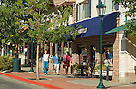 Girlfriends window shopping in front of Aspen and Evergreen Gallery on a autumn morning in downtown Estes Park, Colorado, high in the Rocky Mountains