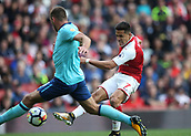 9th September 2017, Emirates Stadium, London, England; EPL Premier League Football, Arsenal versus Bournemouth; Alexis Sanchez of Arsenal taking a shot past Steve Cook of Bournemouth