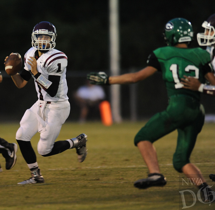 NWA Democrat-Gazette/ANDY SHUPE<br /> Jon &quot;Doo&quot; Faulkenberry (1) of Gentry looks to pass as Michael McAdoo of Greenland defends Friday, Sept. 18, 2015, during the first half of play at Jonathan Ramey Memorial Stadium in Greenland. Visit nwadg.com/photos to see more photographs from the game.