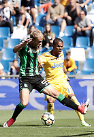 Calcio, Serie A: Reggio Emilia, Mapei stadium, 17 settembre 2017.<br /> Juventus Douglas Costa in action with Sassuolo's Timo Letschert during the Italian Serie A football match between Sassuolo and Juventus at Reggio Emilia's Mapei stadium, September 17, 2017.<br /> UPDATE IMAGES PRESS/Isabella Bonotto