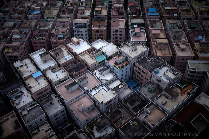"Densely packed apartment buildings are seen from above in Shenzhen, China on Feb. 6 2012. The apartments are often called ""handshake buildings"" because they are so close that neighbors can reach across."