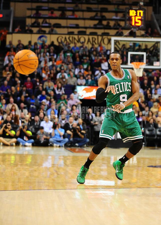 Jan. 28, 2011; Phoenix, AZ, USA; Boston Celtics guard Rajon Rondo (9) makes a pass against the Phoenix Suns at the US Airways Center. Mandatory Credit: Mark J. Rebilas-