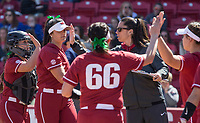 NWA Democrat-Gazette/BEN GOFF @NWABENGOFF<br /> Courtney Deifel, Arkansas head coach, high-fives pitcher Mary Haff and catcher Taylor Greene in the 4th inning vs South Carolina Sunday, March 17, 2019, at Bogle Park in Fayetteville.