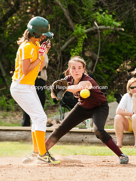 WATERBURY, CT-27 May 2014-052714EC02-  Holy Cross' Becca Anderson gets back to first base safely in front of Naugatuck's Sandra Dinis. The Greyhounds defeated the Crusaders, 6-3, in the NVL softball quarterfinals Tuesday in Waterbury. Erin Covey Republican-American