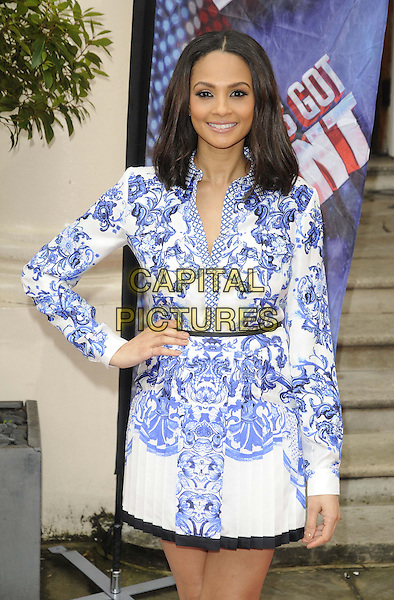 Alesha Dixon.The Britain's Got Talent 2013 press launch, ICA, Carlton House, The Mall, London, England..April 11th, 2013.half length white blue black floral print dress long sleeves belt pleats pleated hand on hip     .CAP/CAN.©Can Nguyen/Capital Pictures.