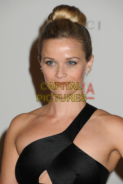 Reese Witherspoon.The Inaugural Art and Film Gala held at LACMA in Los Angeles, California, USA..November 5th, 2011.headshot portrait black one shoulder hair up bun hair.CAP/ADM/BP.©Byron Purvis/AdMedia/Capital Pictures.