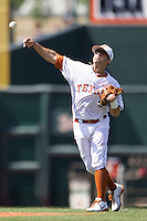 Texas Longhorns shortstop CJ Hinojosa #9 makes a throw to first base against the Oklahoma Sooners in the NCAA baseball game on April 6, 2013 at UFCU DischFalk Field in Austin, Texas. The Longhorns defeated the rival Sooners 1-0. (Andrew Woolley/Four Seam Images).