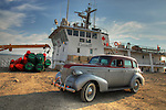 Vintage car and Coast Guard vessel at Norman Wells.