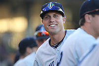 Lake County Captains outfielder Jordan Casas #24 smiles in the dugout during a game against the Dayton Dragons at Fifth Third Field on June 25, 2012 in Dayton, Ohio. Lake County defeated Dayton 8-3. (Brace Hemmelgarn/Four Seam Images)