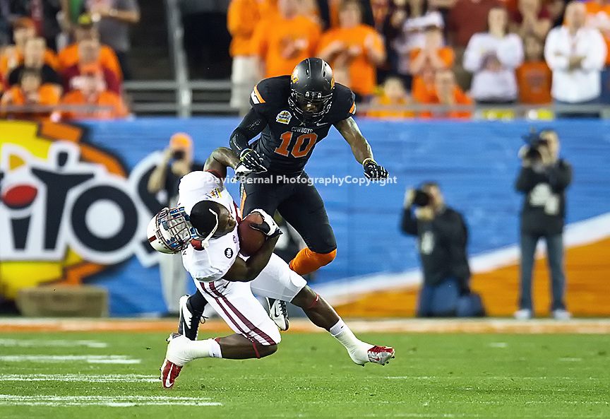 STANFORD, CA - January 2, 2012: Stanford wide receiver Ty Montgomery (88) receives a hard hit from Oklahoma State safety Markelle Martin (10) at the Fiesta Bowl at University of Phoenix Stadium in Phoenix, AZ. Final score Oklahoma State wins 41-38.